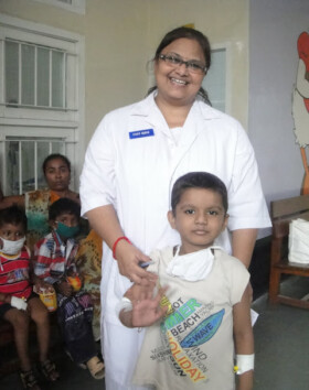 Susmita, with Alok (5Yrs). Alok was very keen to get himself photographed.