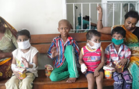 Kids undergoing chemotherapy treatment carrying their boxes of protein and biscuits