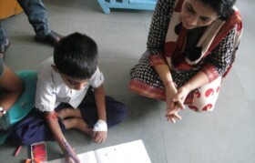Volunteer appreciating the work of  an artist.