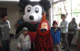Team volunteers came along with characters like Mickey Mouse and clowns to amaze children.