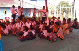 School children and other locals already gathered for camp