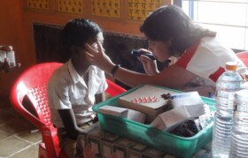 Dr Swapna Shanbhag checking one of the patients