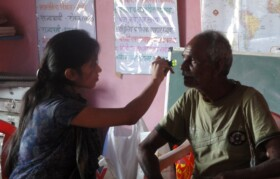 Optometrist Prateeksha checking senior patients