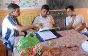 Volunteers Vivek, Milind and Ashish reviewing patient data in the break
