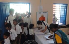 Volunteers managing the queues and registration desks.