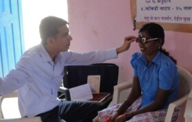 Qualified optometrists carrying out examinations.