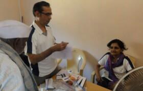 Doctors and volunteer dispensing medicine.