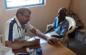 Dr Bimal checking patient.