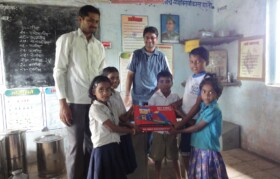 Kids from Bahiram Pada receiving gift of games from Team Suhrid