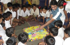 Ashish from Team Suhrid explaining the game of carrom to kids.