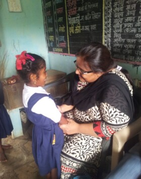 Founder member Ms Sumita Tembe talking to a girl from the school.