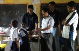 Students getting sports equipments