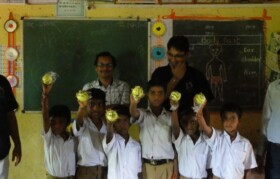 Kids are very proudly showing their new possession - Tennis balls!