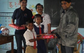 Team Suhrid distributing games.