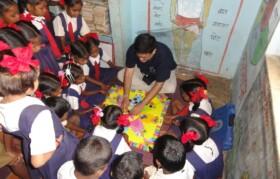 Volunteers explaining the game to kids
