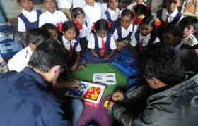 Volunteers explaining the games to kids and trying their hands too! :-)