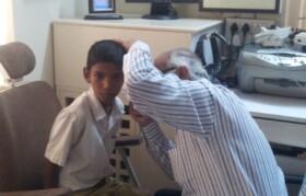 Dr Jobanputra checking kid