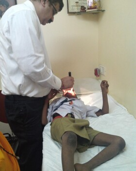 Kid being cheked by Dr Rajani