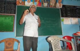 Mr Pranajape explaining water conservation to villagers