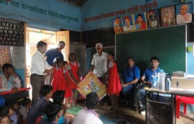 Sports items being given to children by chief guest