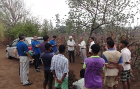 Mr Paranjape explaining water conservation to villagers
