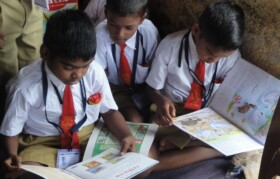 Children immediately engrossed in reading