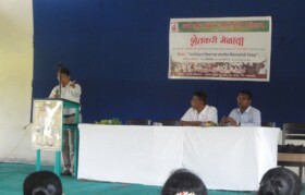Agricultural experts addressing farmers in the region