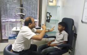 Dr Mihir Kothari checking Kiran Tokare from Kaspada