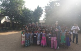 Group photo requested by children with Dr Vjay Patel
