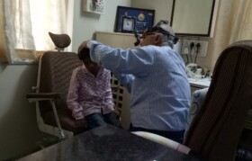 Dr Jobanputra checking a kid from Bahirampada